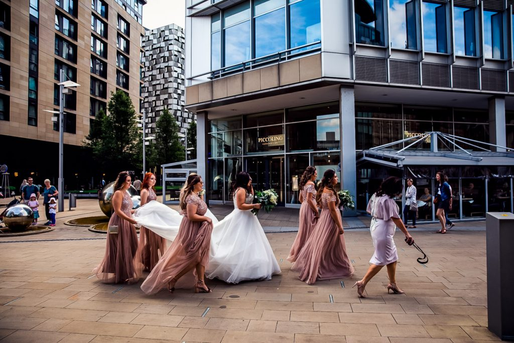 Sheffield Town Hall wedding bride and bridesmaids walking across the scene and through the city centre