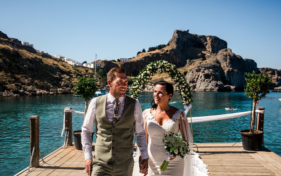 bride and groom walking down the aisle of St Pauls Bay after getting married