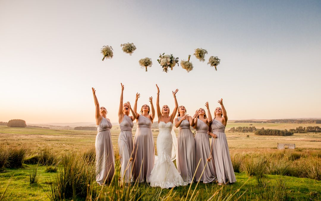 woodhill hall wedding bridesmaids throwing their flowers in the air in northumberland
